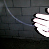 """This still image of a """"thread of energy"""" (or orb thread as I referred to it in the video) connecting me with The Light of Jesus; as  captured on video the evening of October 18, 2014. The thread was actually placed across my fingers but the flash from my camera washed out this detail."""