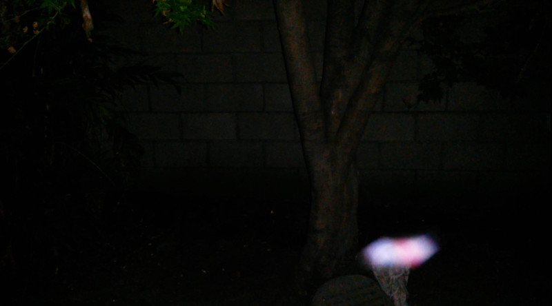 "This is the ninth still image, of 17 images presented, of The Light of Archangel Uriel that was captured on video the evening of March 20, 2016.  In this image, Uriel is consciously brushing over the top of the angel statue. Look at her colors! Some people refer to Uriel as a ""he"" but Uriel usually appears to me in feminine colors, so I say ""she."""