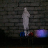 This is one still image, of two images presented, of Archangel Raphael; as captured on video Good Friday, March 25, 2016.  I had just purchased the Waterford Crystal Cross and placed the Cross in front of the Jesus statue, which was a Christmas gift from my brother. I also placed blue and red dyed daisies on each side of the Cross. Archangel Raphael appeared to come out of the base of the statue and first appeared golden in color. As Raphael moved forward, his Light turned electric blue with hints of pink and gold, then morphed into blue and gold (which can be seen in the next image), then all gold before he disappeared.