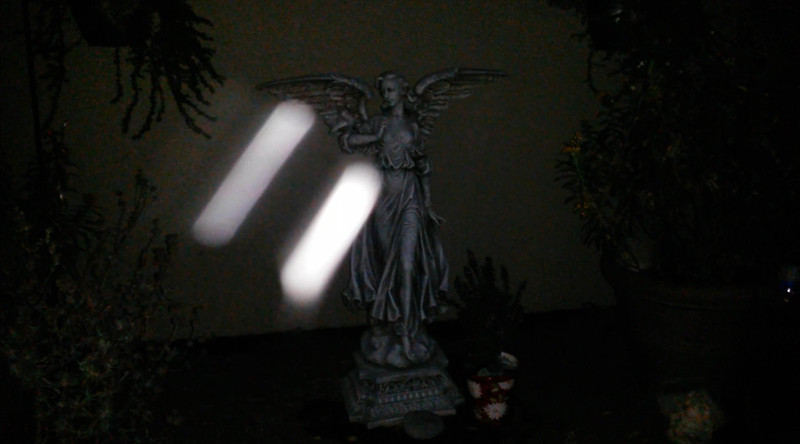 This is the third still image, of five images presented, of Archangels Michael and Ariel (on the left side of the frame) ascending by my large Angel statue. Can you see their energy fields extending out from their Light bodies? <br /> <br /> Their brilliance was captured on video the evening of September 17, 2016.