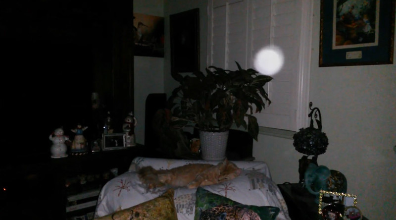 This is one still image, of three images presented, of The Light of Jesus with my cat, Tom; as captured on video the evening of September 20, 2017.