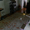 This is one still image, of two images presented, of Archangels Ariel (white orb on the rug) and Gabriel (translucent orb at the base of the cat furniture) with my cat, Canoodle; as captured on video the morning of July 16, 2014.