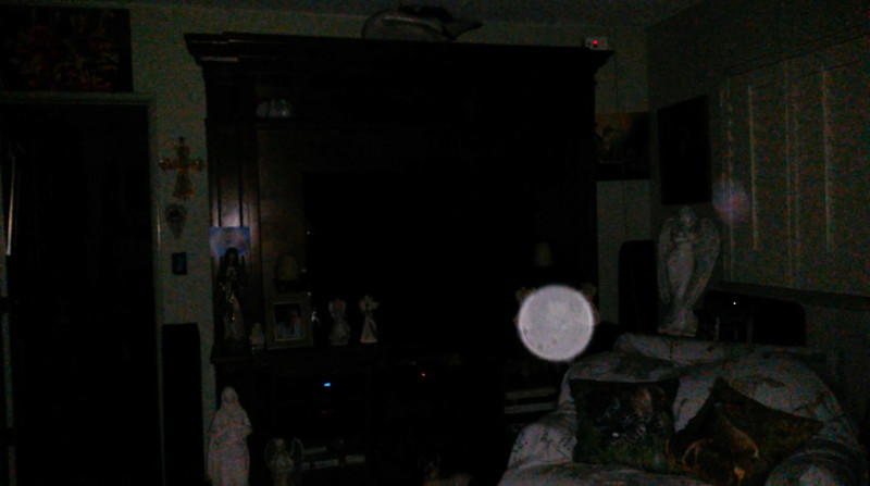 This is one still image, of three images presented, of The Light of Mary Magdalene (with Archangel Raziel appearing by the Angel statue); as captured on video the evening of January 18, 2019.