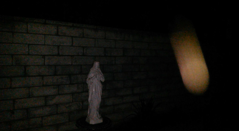 This is the second still image, of three images presented, of The Light of Jesus descending by my Jesus statue; as captured on video the evening of September 2, 2017.