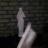 This is one still image, of two images presented, of The Light of Jesus  ascending near my Jesus statue, which was captured on video the evening of December 23, 2015. This 3 foot statue was an early Christmas present from my brother.