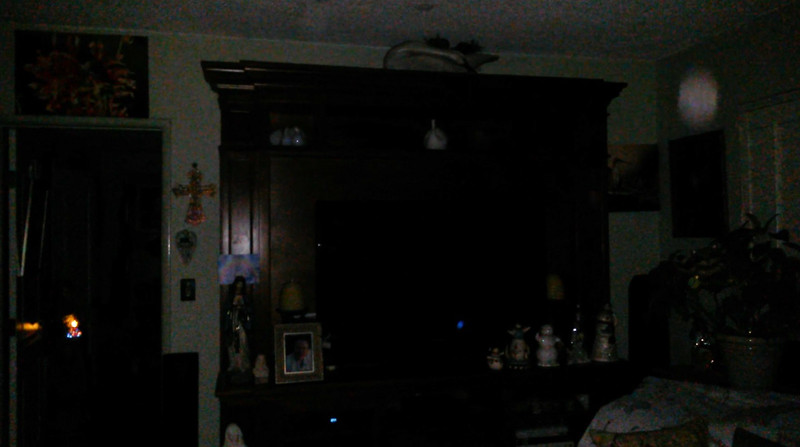 This is a still image of The Light of Mother Mary with The Light of a Fairy (small bright blue colored Light on the TV screen); as captured on video the evening of September 5, 2018.