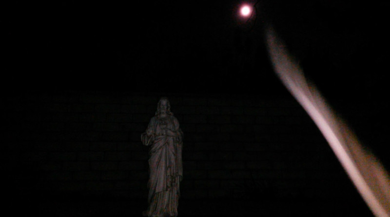 This is the third still image, of four images presented, of The Light of Jesus descending by my new Jesus statue; as captured on video the evening of December 31, 2017.