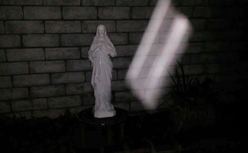 This is the second still image of The Light of Jesus  ascending near my Jesus statue, which was captured on video the evening of December 23, 2015.