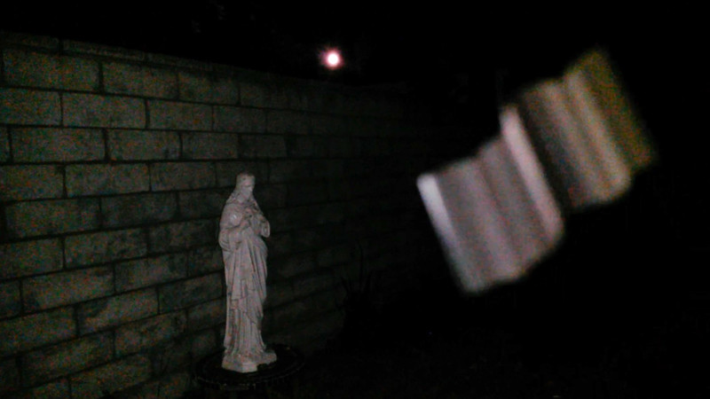 "This is one still image, of two images presented, of The Light of Jesus ascending by my Jesus statue; as captured on video the evening of the full ""Strawberry Moon"" June 9, 2017."