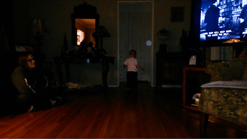 "This is the second still image, of three images presented, of The Light of Jesus with my great nephew; as captured on video Christmas Day 2014.  Also in this image is my niece sitting on the floor of my mother's living room and watching one of my favorite holiday movies: ""The Bishop's Wife."""