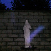 This is the fourth still image, of five images presented, of The Light of Jesus; as captured on video on the evening of June 6, 2017. On this evening, I had placed a purple flower at the base of the statue, so of course, Jesus acknowledged my gesture by appearing as a purple and blue Light!