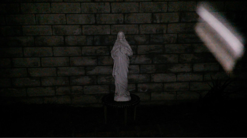 """I was so excited to capture this still image, from video, of The Light of Jesus ascending by my Jesus statue. His form on this evening, February 2, 2017, was exactly as He appeared to me on December 23, 2015, which was the day my brother gifted me with this statue. I see His form like a scroll. If we picture a scroll, we can look at one section of it, but there is much more of it still rolled up which comes before and after what we are looking at. The same with a book: we can see the pages which are open, but all the other pages are hidden until we turn to them. If we ask, God will reveal a portion or an aspect of what is on our scroll: He may show it to us, read it to us, or tell us in some other way. But we will know. And, depending on what we do with the portion He has revealed, He is always willing to show us more.<br /> <br /> Psalm 139:16: """"All the days ordained for me were written in your book  (scroll) before one of them came to be."""""""
