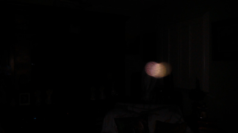 This is a still image of The Light of Mother Mary; as captured on video the evening of July 2, 2019.  This image has been underexposed to show the colors, form, and brilliance of Her Light.
