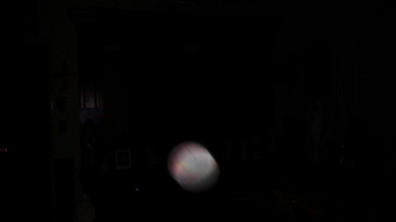 This is a still image of The Light of Mother Mary; as captured on video the evening of July 30, 2019.  This image has been underexposed to show the colors of Her Light in the dark.