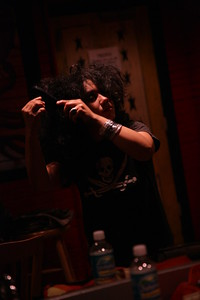 Milkanette Ramos of MILKA teases her hair prior to her performance at House of Blues Orlando on 08-11-2007