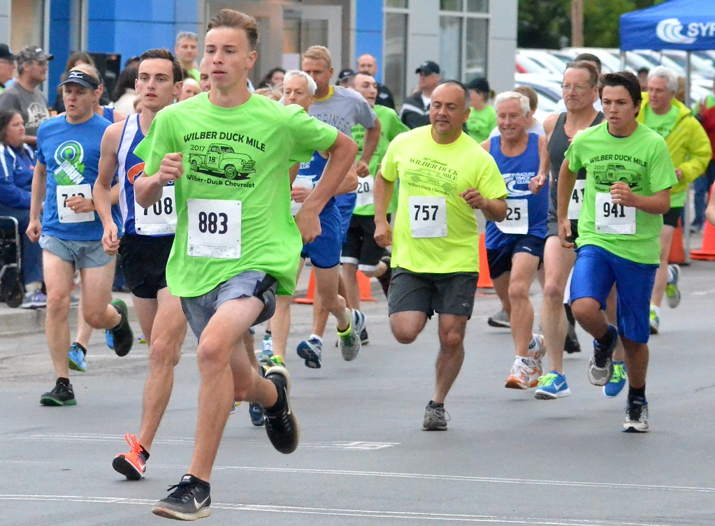 . KYLE MENNIG - ONEIDA DAILY DISPATCH Runners leave the start line for the men\'s race at the 18th annual Wilber-Duck Mile in Oneida on Friday, May 19, 2017.