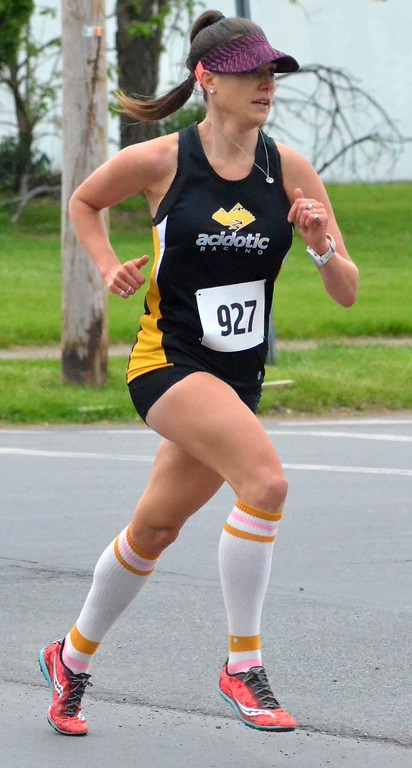 . KYLE MENNIG - ONEIDA DAILY DISPATCH Jaime Woolsey nears the finish line to place second in the women\'s race at the 18th annual Wilber-Duck Mile in Oneida on Friday, May 19, 2017.