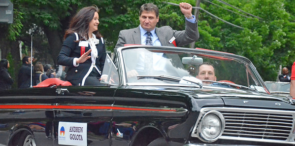 KYLE MENNIG - ONEIDA DAILY DISPATCH Andrew Golota gestures to the crowd during the International Boxing Hall of Fame Induction Weekend Parade of Champions in Canastota on Sunday, June 12, 2016.