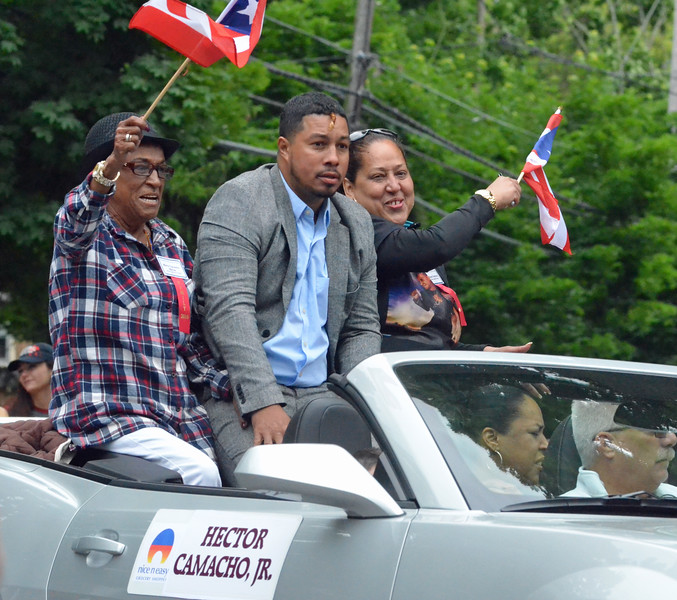 KYLE MENNIG - ONEIDA DAILY DISPATCH The family of Hector Camacho gestures to the crowd during the International Boxing Hall of Fame Induction Weekend Parade of Champions in Canastota on Sunday, June 12, 2016.