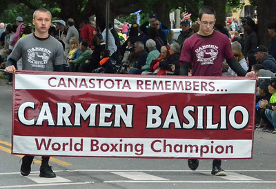 KYLE MENNIG - ONEIDA DAILY DISPATCH A banner honoring the late Carmen Basilio during the International Boxing Hall of Fame Induction Weekend Parade of Champions in Canastota on Sunday, June 12, 2016.