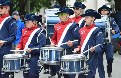 KYLE MENNIG - ONEIDA DAILY DISPATCH The Pulaski marching band marches in the International Boxing Hall of Fame Induction Weekend Parade of Champions in Canastota on Sunday, June 12, 2016.