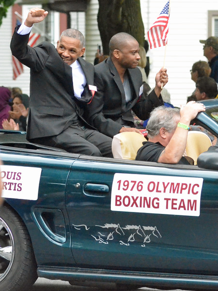 KYLE MENNIG - ONEIDA DAILY DISPATCH Louis Curtis gestures to the crowd during the International Boxing Hall of Fame Induction Weekend Parade of Champions in Canastota on Sunday, June 12, 2016.