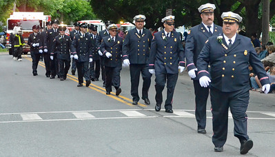 KYLE MENNIG - ONEIDA DAILY DISPATCH The Canastota Fire Department marches in the International Boxing Hall of Fame Induction Weekend Parade of Champions in Canastota on Sunday, June 12, 2016.