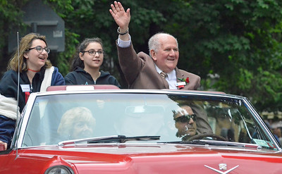 KYLE MENNIG - ONEIDA DAILY DISPATCH Class of 2016 inductee Harold Lederman gestures to the crowd during the International Boxing Hall of Fame Induction Weekend Parade of Champions in Canastota on Sunday, June 12, 2016.