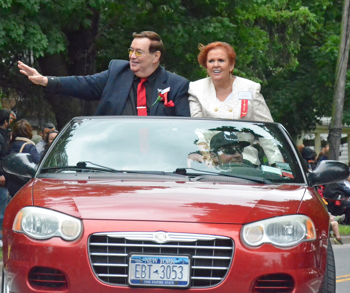 KYLE MENNIG - ONEIDA DAILY DISPATCH Class of 2016 inductee Col. Bob Sheridan gestures to the crowd during the International Boxing Hall of Fame Induction Weekend Parade of Champions in Canastota on Sunday, June 12, 2016.