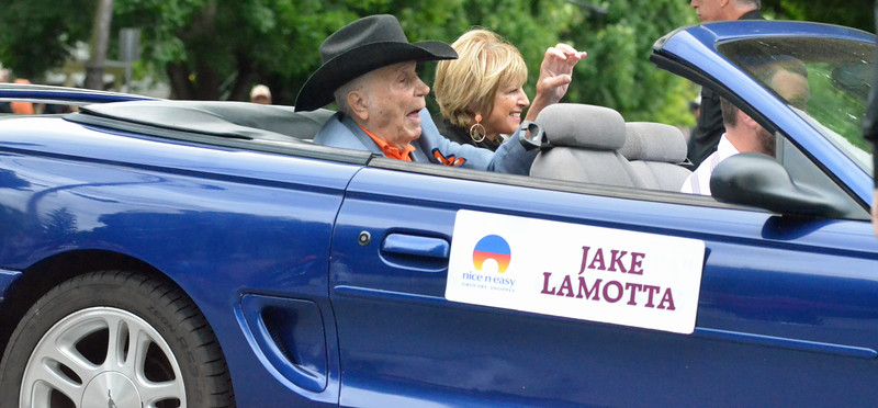 KYLE MENNIG - ONEIDA DAILY DISPATCH Jake LaMotta gestures to the crowd during the International Boxing Hall of Fame Induction Weekend Parade of Champions in Canastota on Sunday, June 12, 2016.