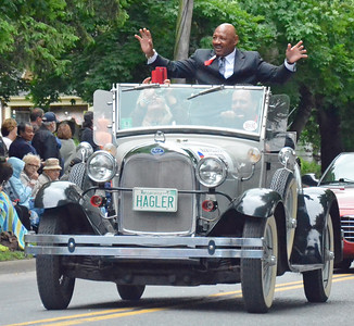 KYLE MENNIG - ONEIDA DAILY DISPATCH Marvin Haggler gestures to the crowd during the International Boxing Hall of Fame Induction Weekend Parade of Champions in Canastota on Sunday, June 12, 2016.