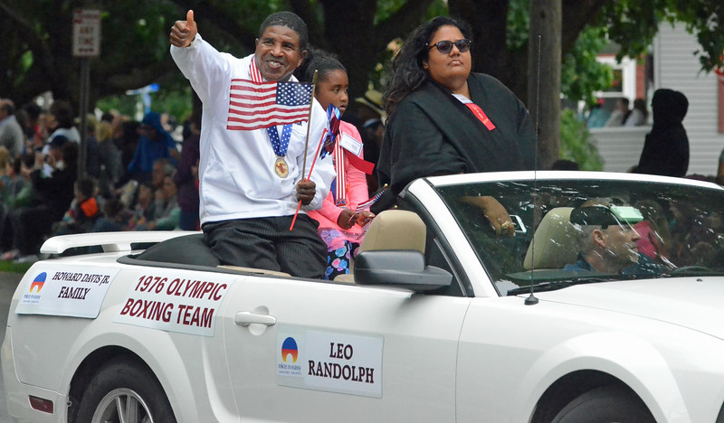 KYLE MENNIG - ONEIDA DAILY DISPATCH Leo Randolph, a 1976 Olympic gold medalist, gestures to the crowd during the International Boxing Hall of Fame Induction Weekend Parade of Champions in Canastota on Sunday, June 12, 2016.
