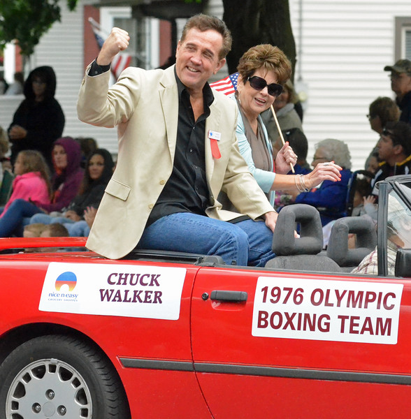 KYLE MENNIG - ONEIDA DAILY DISPATCH Chuck Walker gestures to the crowd during the International Boxing Hall of Fame Induction Weekend Parade of Champions in Canastota on Sunday, June 12, 2016.