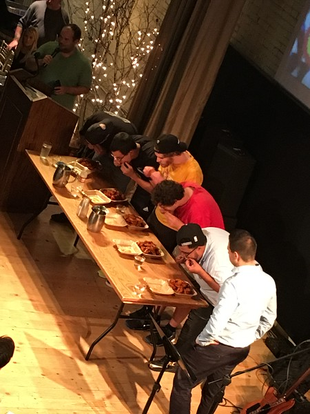 Staff and volunteers from the Boys & Girls Clubs of Albany and Troy compete in a wing-eating contest during the second annual Capital Region WingFest on Thursday night at Brown's Revolution Hall in downtown Troy.