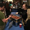 A guest samples the smoked heavy whiskey garlic wings offered by host Brown's Brewing Company that were chosen as the best wing at the second annual Capital Region WingFest on Thursday night at Brown's Revolution Hall in downtown Troy.