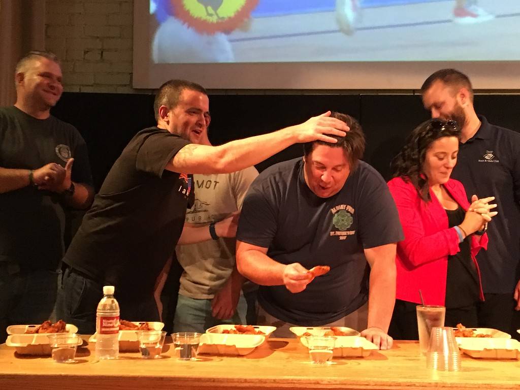 . A team of Albany firefighters competes against a team of staff and volunteers from the Boys & Girls Clubs of Albany and Troy during the second annual Capital Region WingFest on Thursday night at Brown\'s Revolution Hall in downtown Troy.