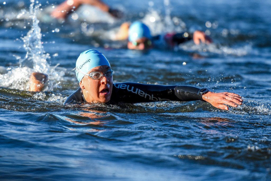 . A swimmer reaches for her next stroke during the Lake to Lake Triathlon on Saturday June 23, 2018 at North Lake Park in Loveland. (Cris Tiller / Loveland Reporter-Herald)