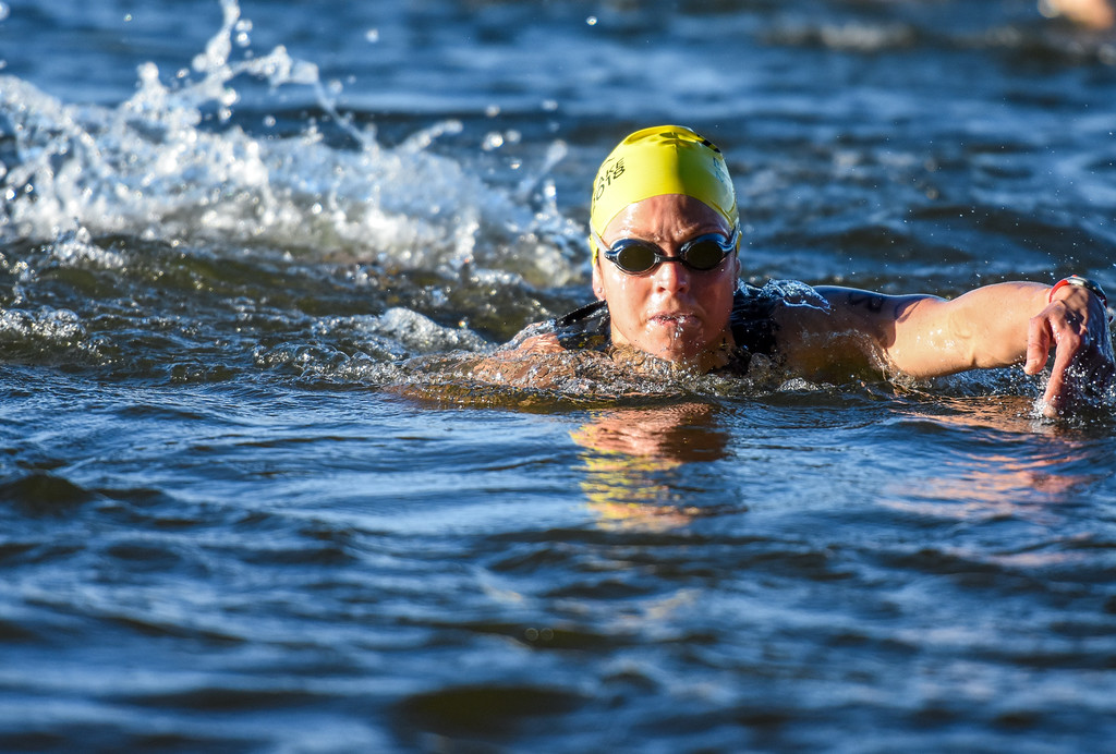 . A swimmer nears the beach during the Lake to Lake Triathlon on Saturday June 23, 2018 at North Lake Park in Loveland. (Cris Tiller / Loveland Reporter-Herald)