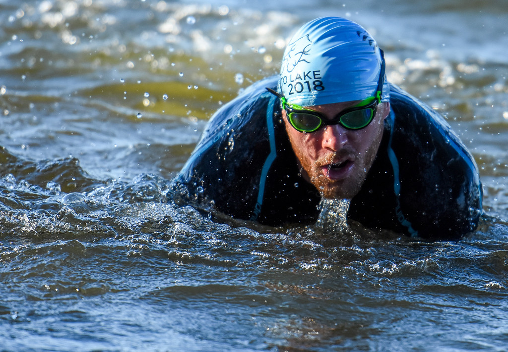 . A competitor picks himself up out of the water during the Lake to Lake Triathlon on Saturday June 23, 2018 at North Lake Park in Loveland. (Cris Tiller / Loveland Reporter-Herald)