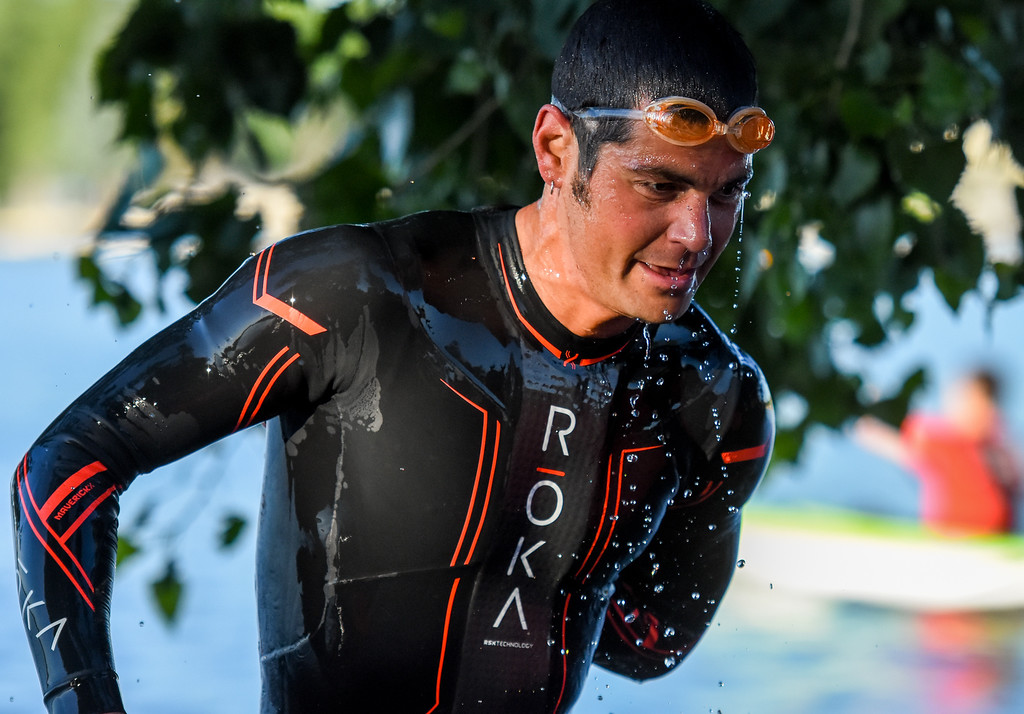 . Colin Laughery drips water after exiting the swimming portion of the Lake to Lake Triathlon on Saturday June 23, 2018 at North Lake Park in Loveland. (Cris Tiller / Loveland Reporter-Herald)