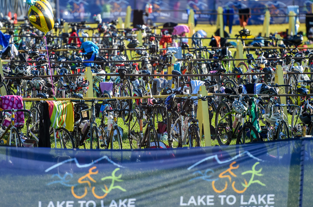 . Bikes await their riders during the Lake to Lake Triathlon on Saturday June 23, 2018 at North Lake Park in Loveland. (Cris Tiller / Loveland Reporter-Herald)