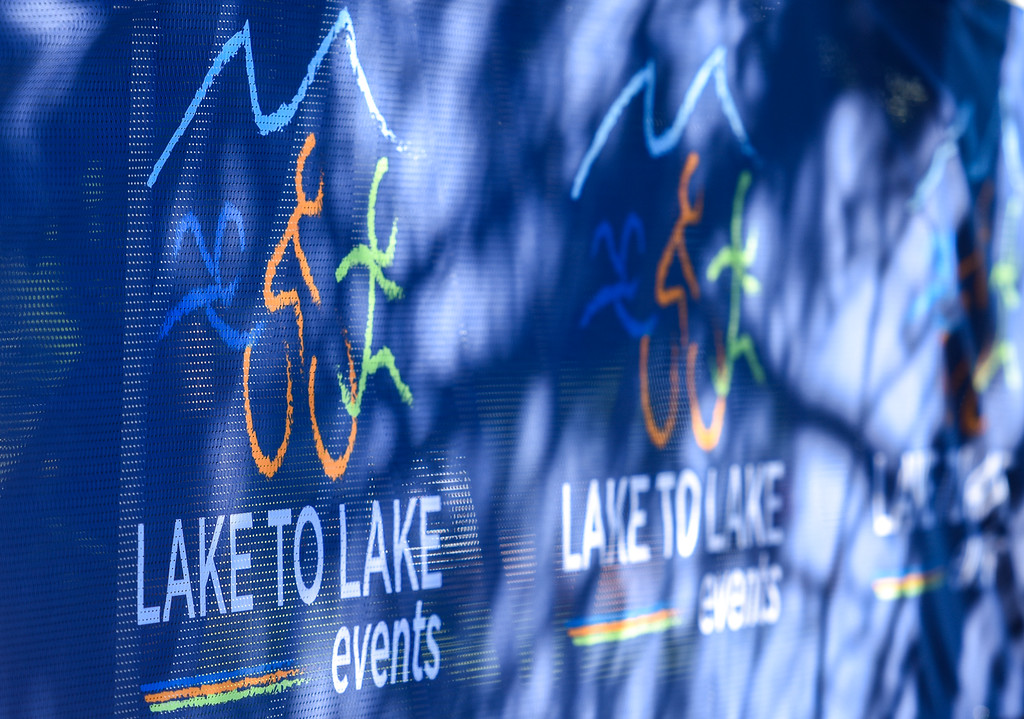 . Signage leads to the finish line of  the Lake to Lake Triathlon on Saturday June 23, 2018 at North Lake Park in Loveland. (Cris Tiller / Loveland Reporter-Herald)
