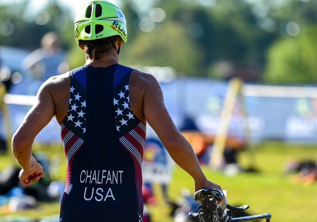 . Robby Chalfant is the second man to return to the bike staging area in advance of the final run during the Lake to Lake Triathlon on Saturday June 23, 2018 at North Lake Park in Loveland. (Cris Tiller / Loveland Reporter-Herald)