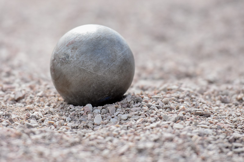 A shot put rests in the pit after being thrown during the R2J Meet on Thursday April 12, 2018 at LHS. (Cris Tiller / Loveland Reporter-Herald)