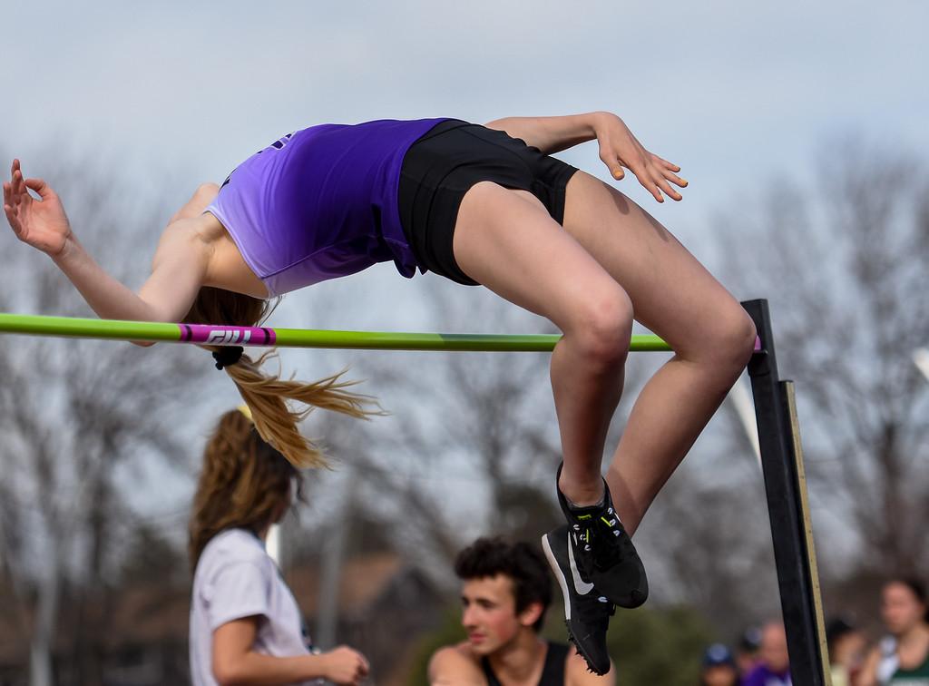 . Mountain View\'s Chloe Miller clears the high jump bar during the R2J Meet on Thursday April 12, 2018 at LHS. (Cris Tiller / Loveland Reporter-Herald)
