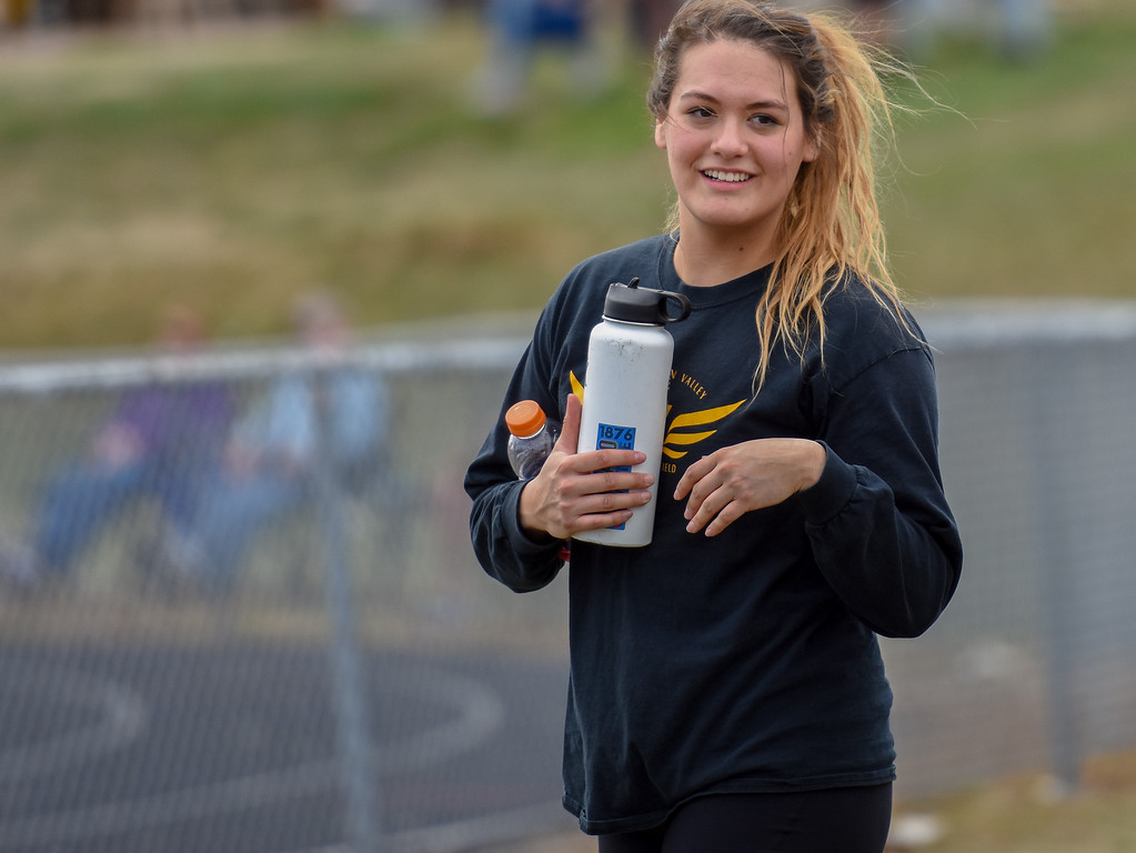 . Thompson Valley\'s Cindy Ybarra smiles after winning the discus throw during the R2J Meet on Thursday April 12, 2018 at LHS. (Cris Tiller / Loveland Reporter-Herald)