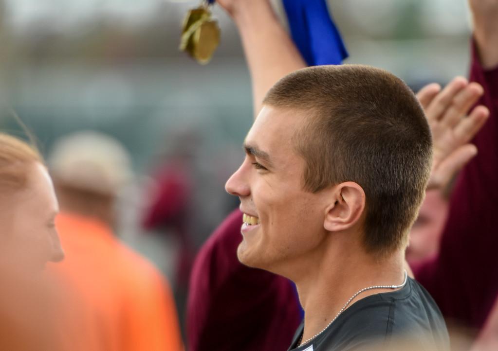 . Berthoud\'s boys celebrate winning the exhibition 4x50 meter relay during the R2J Meet on Thursday April 12, 2018 at LHS. (Cris Tiller / Loveland Reporter-Herald)