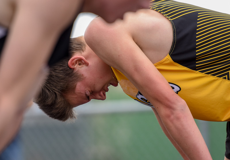 Thompson Valley's Dylan Schubert hunches over with exhaustion after finishing the 1,600-meter run during the R2J Meet on Thursday April 12, 2018 at LHS. (Cris Tiller / Loveland Reporter-Herald)