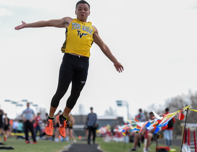 Thompson Valley's Andrew Hernandez flies through the air for a long jump during the R2J Meet on Thursday April 12, 2018 at LHS. (Cris Tiller / Loveland Reporter-Herald)