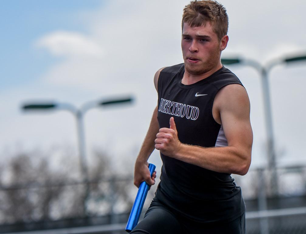 . Berthoud\'s Jake Rafferty runs his leg of the 800-meter relay during the R2J Meet on Thursday April 12, 2018 at LHS. (Cris Tiller / Loveland Reporter-Herald)